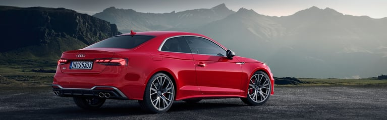 The Audi S5 Coupé parked in the mountains.