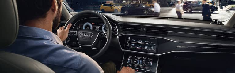 Interior view of the dual screen MMI touch response system and Audi virtual cockpit.