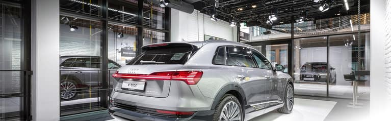 Rear profile of the Audi e-tron parked on display.